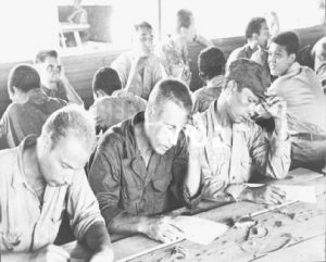62nd Replacement Depot at Manila. 1945. Ex-POW's fill in registration forms.